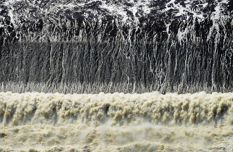 St. Anthony Falls was roaring Friday in downtown Minneapolis. (Pioneer Press: Ben Garvin)