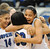 Hopkins Royals forward Nia Coffey (32), facing camera, hugs teammate Ashley Bates (30) after they beat Bloomington Kennedy to claim the Class 4A girls state basketball championship Saturday, March 16, 2013, at Target Center in Minneapolis. Also celebrating is guard Mikaala Shackelford (14). (Pioneer Press: John Autey)