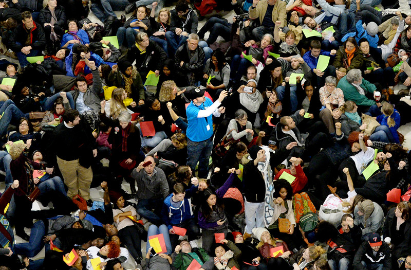 A Mall of America staff member takes video of the demonstration as protesters lay down in the rotunda. (Pioneer Press: John Autey)