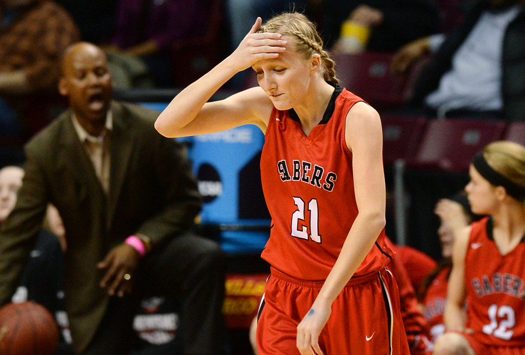 Description of . Shakopee junior guard Allyson Johnston slaps herself on the forehead after tossing the ball out of bounds on a pass against Hopkins in the second half of a Minnesota State High School 4A Girls Basketball Tournament semifinal game at Williams Arena on Thursday, March 19, 2015. Hopkins beat Shakopee, 64-33. (Pioneer Press: John Autey)