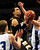 Apple Valley's Tyus Jones drives to the basket to score two of his game-high 19 points between Brainerd's Jack Sauer, left, and Chris Bowman, during the Eagles' 81-67 win in the Class 4A quarterfinal game of the boys state high school tournament at Target Center in Minneapolis on Wednesday, March 20, 2013. (Pioneer Press: Scott Takushi)