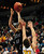Johnson's Robert Chattard goes up for a shot over DeLaSalle's Luke Scott in the second half.  (Pioneer Press: Scott Takushi)