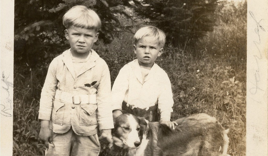 "Description of . JUST JENNIFER of West St. Paul: ""When going through some old photos, I found this one of two boys and their dog, which was sent to my grandmother. On the back, it reads: 'To Mrs. Otto Hohle From Mrs. Ed Christofferson; Roy Harry Christofferson taken July 1928.' You can faintly read in the margins of the photo that Roy is on the left and Harry is on the right. There is another name, which I assume is the dog's name, but I cannot make it out. My grandmother's dog was named Shep, but the writing doesn't look like that, and Shep had a narrower blaze. If Roy or Harry Christofferson or their descendants are interested in having the photo, please let me know. My grandmother lived in Grygla, Minnesota, so I'm assuming they were friends up there."""