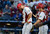 Canada reliever Jim Henderson, left, walks back to the mound with catcher Chris Robinson after giving up a run to the United States in the eighth inning. (AP Photo/Ross D. Franklin)