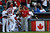 Canada's Michael Saunders (20) celebrates his tw-run home run against the United States with coach Denis Boucher, left, and a batboy in the second inning. (AP Photo/Ross D. Franklin)