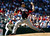 United States' Derek Holland throws a pitch against Canada in the second inning. (AP Photo/Ross D. Franklin)