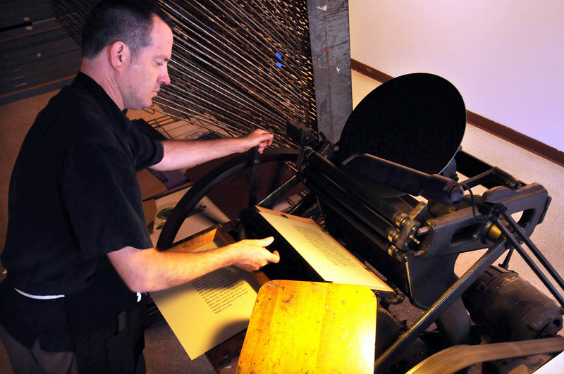 Moran pulls a print to be used in an assignment in one of his classes off a platten press at Hamilton Ink Spot Moran whose family ran a print shop in Green Bay Wis for three generations teaches classes at a local community college Pioneer Press Scott Takushi