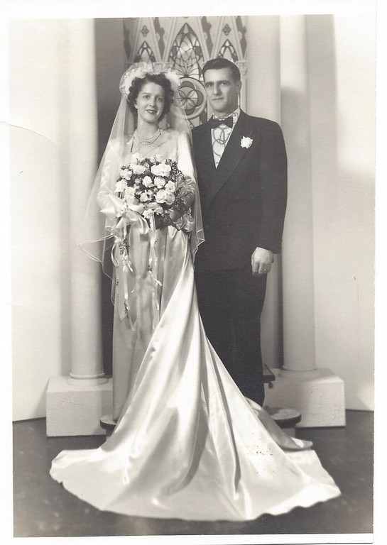 Description of . Writes Mary Ann: A Tribute to our Parents, Walt & Millie (Arcand) Falardeau. <p>Walt served in the Army in World War II in the Pacific. After the War, he moved to St. Paul, where he met Millie. They were married on Feb. 19, 1950, in White Bear Lake and had 8 children right away. On May 28, 1963, at 39 years old, Millie died of cancer, leaving Walt alone to raise eight children, ages 2 to 12 years old.  Walt died on June 4, 1989, at 75 years old of heart disease. Walt and Millie left a legacy of eight children and their spouses, 17 grandchildren and 14 great-grandchildren with another due in July. <p>On May 28th it will be 50 years since our mother died, and on June 4 it will be 24 years since our father died. I am thankful for growing up in a large family.   <p>Happy Memorial Day, as we remember those who have died and how they touched our lives.