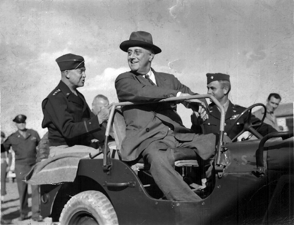 "Description of . Writes WAYNE NELSON of Forest Lake: ""My father took this picture around 1943 while stationed in Castelvetrano, Sicily, with the Army Air Force. As you can see, that's President Roosevelt in the front seat of the Jeep and Gen. Eisenhower sitting in the back seat. I believe the driver to be a Col. Stiles, as my father noted on the back. Behind Eisenhower, in the background to the left, is Gen. Henry 'Hap"" Arnold.