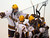 Minnesota players surround Ben Marshall after he scored a goal against Bemidji State in the second period. (AP Photo/Janet Hostetter)