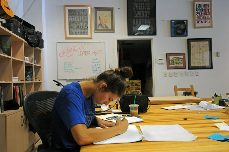 Intern Natalie Wynnings works on a poster design for a concert Pioneer Press Scott Takushi