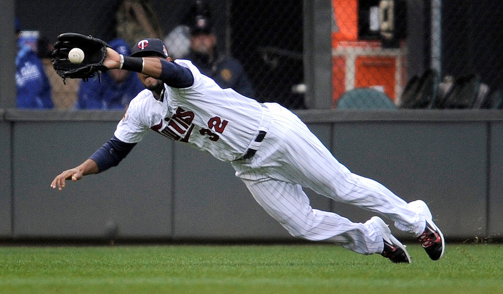 . Minnesota Twins center fielder Aaron Hicks makes the catch on a drive by Kansas City Royals� Eric Hosmer during the first inning. (AP Photo/Tom Olmscheid)