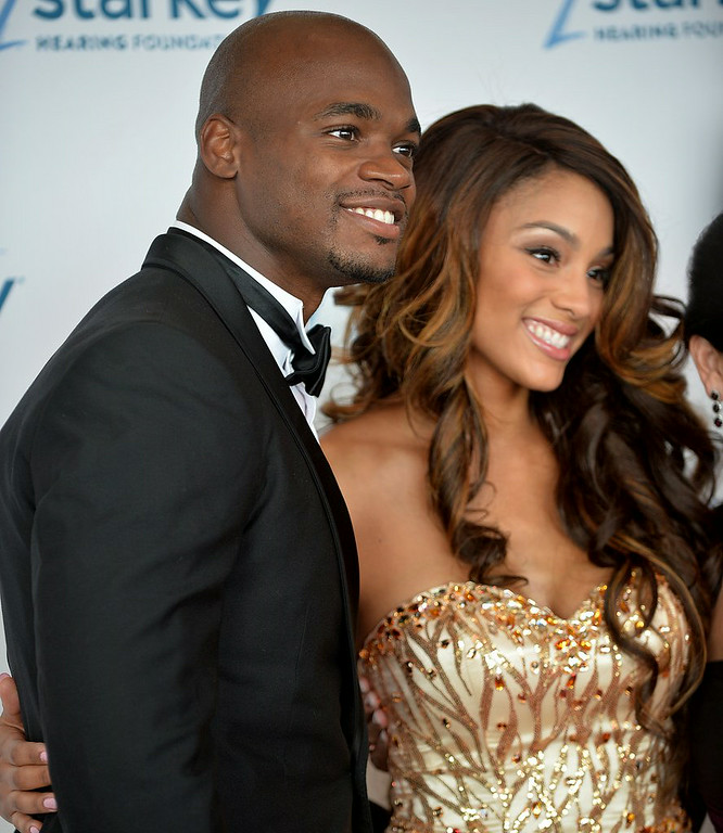 """. <p><b> Fans of the Vikings� Adrian Peterson were surprised to learn this week that he has � </b> </p><p> A. Married his longtime girlfriend </p><p> B. Begun dating a new girlfriend </p><p> C. A 25-year-old daughter </p><p><b><a href=\""""http://www.twincities.com/portal/vikings/ci_26188361/adrian-peterson-married-longtime-girlfriend-has-ring-new?_loopback=1\"""" target=\""""_blank\"""">LINK</a></b> </p><p>    (Pioneer Press: Sherri LaRose-Chiglo)</p>"""
