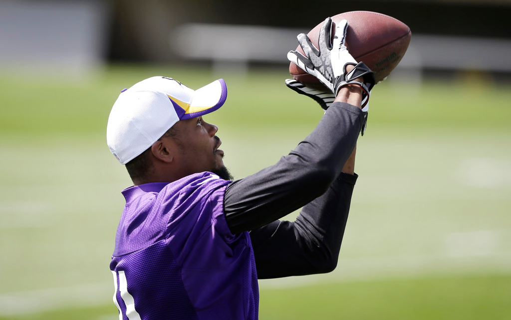 . Vikings wide receiver Jerome Simpson pulls down a pass. (AP Photo/Charlie Neibergall)