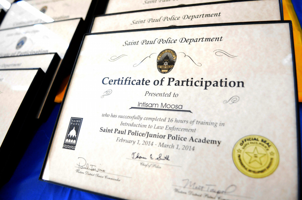 . Framed certificates from the St. Paul Police Department were given to participants of the East African Junior Police Academy graduation ceremony. (Pioneer Press: Sherri LaRose-Chiglo)
