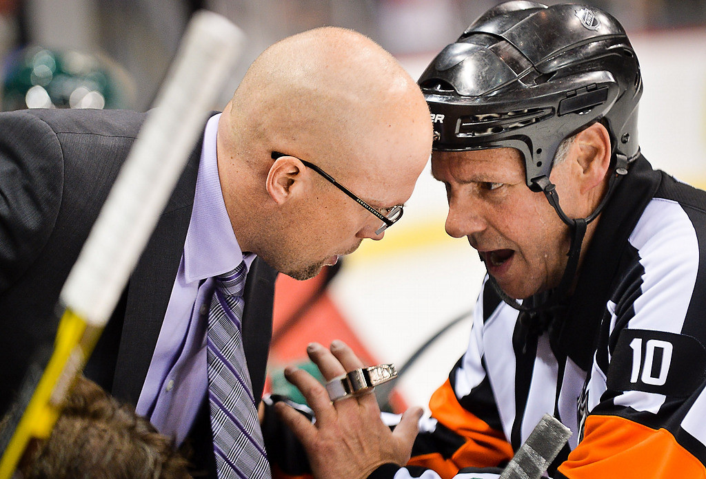 . Minnesota Wild head coach Mike Yeo speaks with referee Gord Dwyer during the third period. (Pioneer Press: Ben Garvin)
