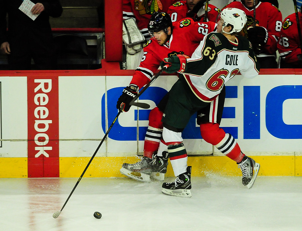. Chicago Blackhawks left wing Viktor Stalberg gets tangled up with Minnesota Wild right wing Charlie Coyle during the first period. (Pioneer Press: Ben Garvin)