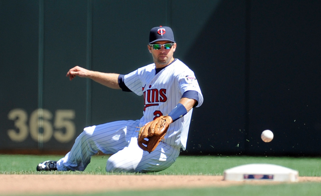 . Twins second baseman Brian Dozier turns a ground ball  hit by Seattle\'s Kendrys Morales into an out during the seventh inning. (AP Photo/Craig Lassig)