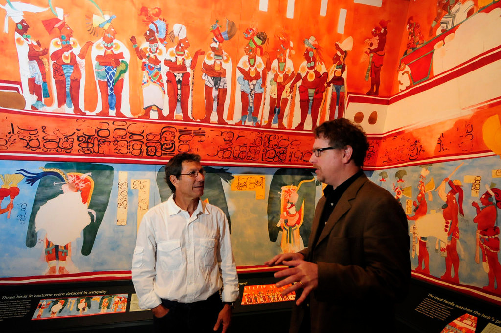 """. Archaeologist  Dr. Jaime Awe, left, and Ed Fleming, Curator of Archaelology at the Science Museum, talk in the \""""Temple of the Murals\"""" at the \""""Maya: Hidden Worlds Revealed\"""" exhibit at the Science Museum of Minnesota. (Pioneer Press: Scott Takushi)"""