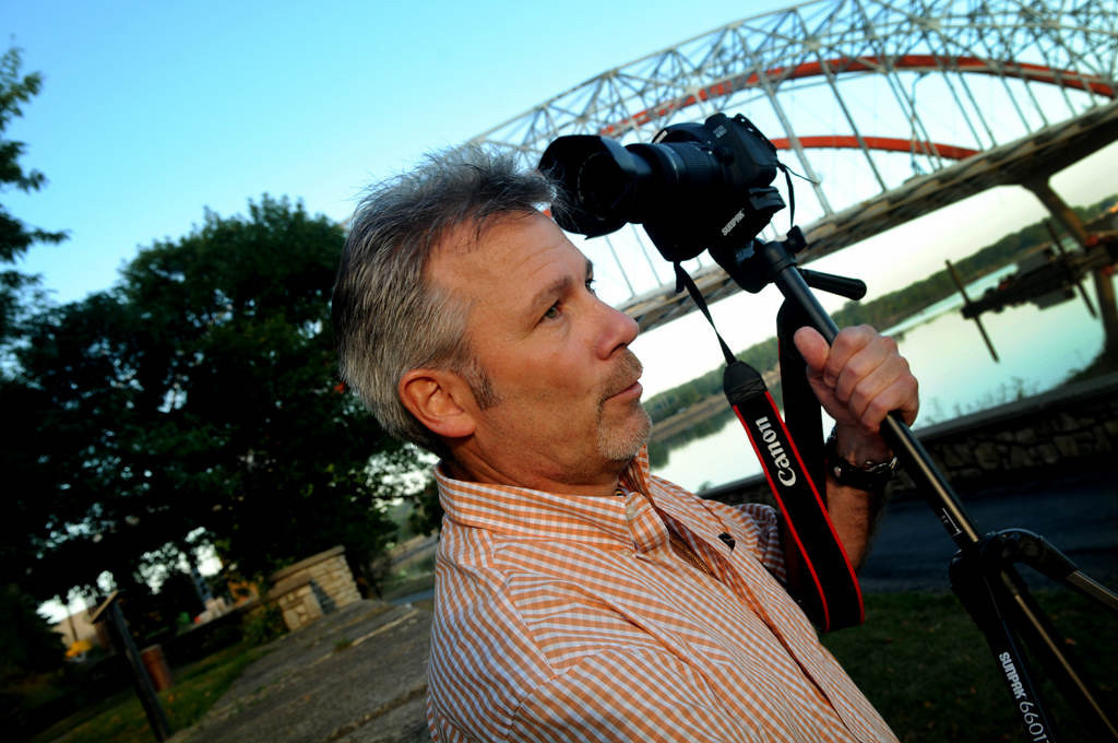 . Dave Youngren moves his camera and tripod to a new location as he takes photos of the bridge work in Hastings on Wednesday. (Pioneer Press: Jean Pieri)