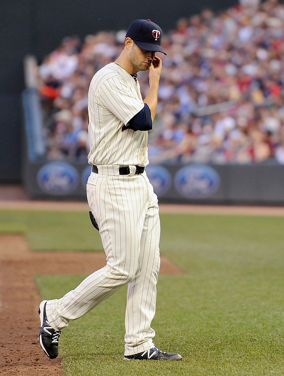 . Twins starting pitcher Scott Diamond leaves the game in the fifth inning. (Photo by Hannah Foslien/Getty Images)