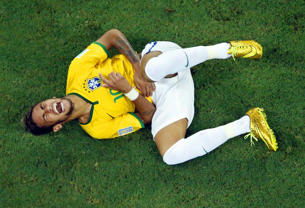 ". <p><b> Brazilian star Neymar was knocked out of the World Cup when he had a vertebrae broken by � </b> <p> A. Juan Camilo Zuniga�s knee <p> B. Arjen Robben�s foot <p> C. Luis Suarez�s bicuspids <p><b><a href=\'http://www.nytimes.com/2014/07/07/sports/worldcup/after-neymar-injury-brazil-seeks-punishment-for-zuniga.html?_r=0\' target=\""_blank\"">LINK</a></b> <p>    (AP Photo/Fabrizio Bensch, pool)"