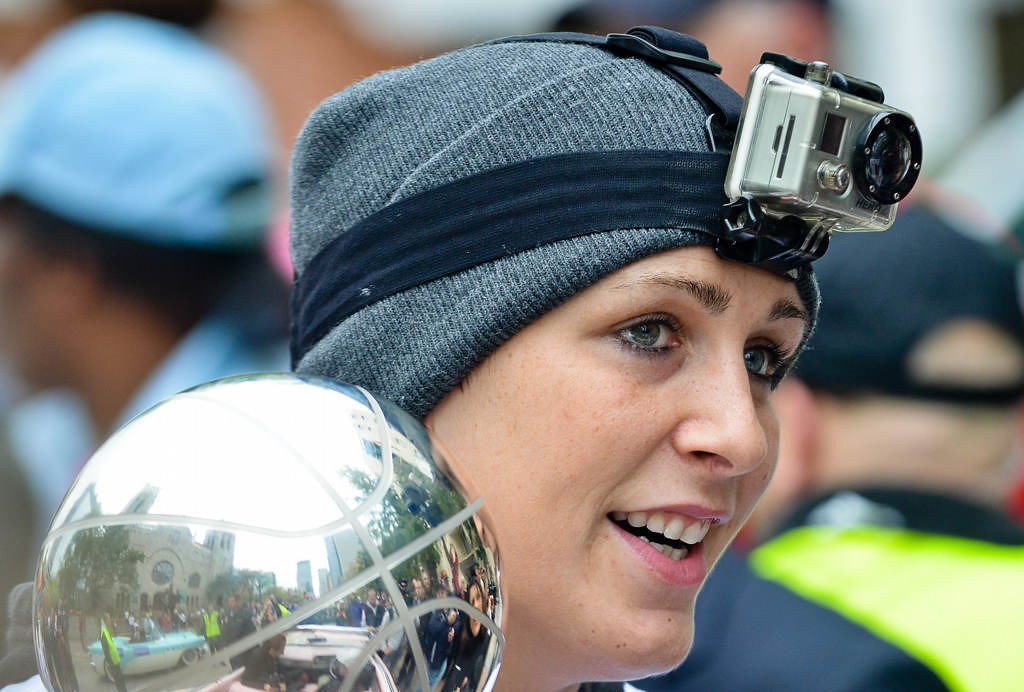 . Janel McCarville wears a GoPro camera on her head as the Minnesota Lynx celebrate their WNBA championship with a parade Monday. (Pioneer Press: Ben Garvin)