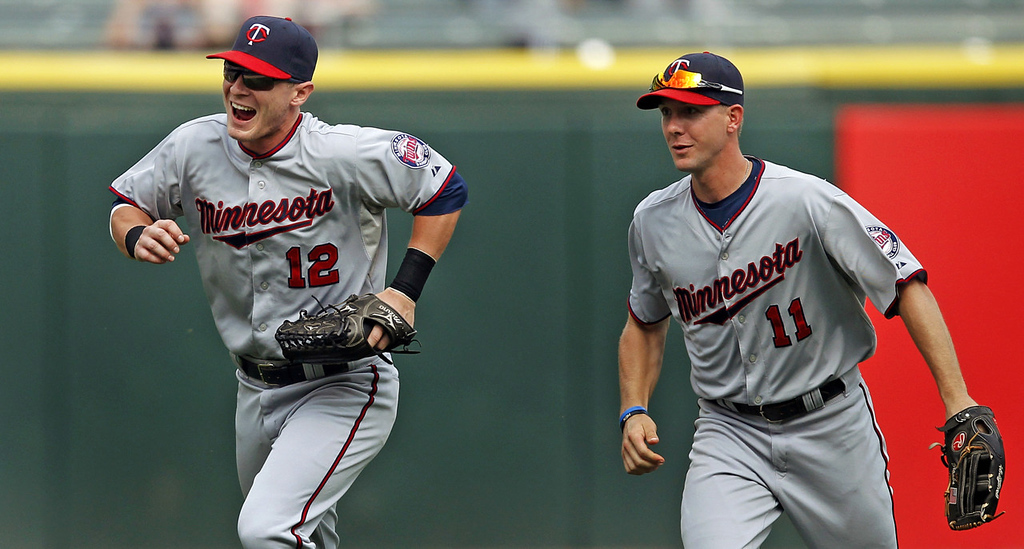 . Twins outfielders Chris Herrmann, left, and Clete Thomas, head for the clubhouse after Minnesota defeated the White Sox in a 5-2 victory. (AP Photo/Andrew A. Nelles)