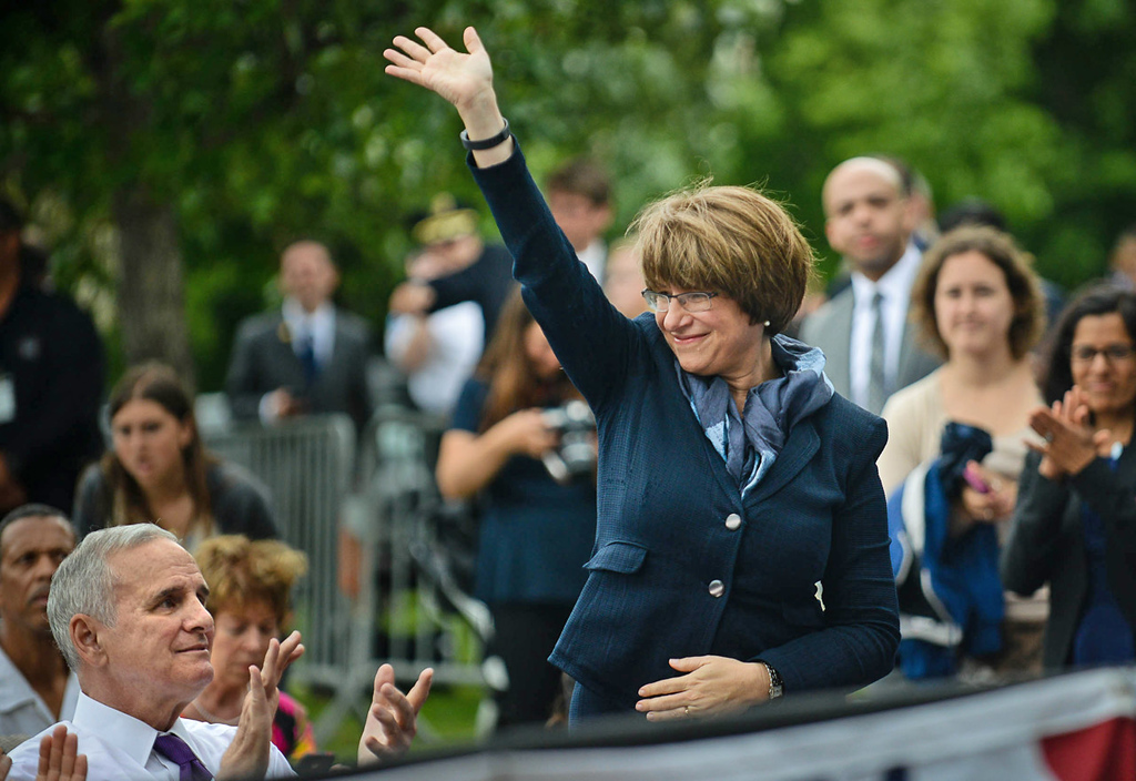 . Senator Amy Klobuchar is recognized by President Barack Obama before he delivered his at the Lake Harriet Bandshell. (Pioneer Press: Ben Garvin)