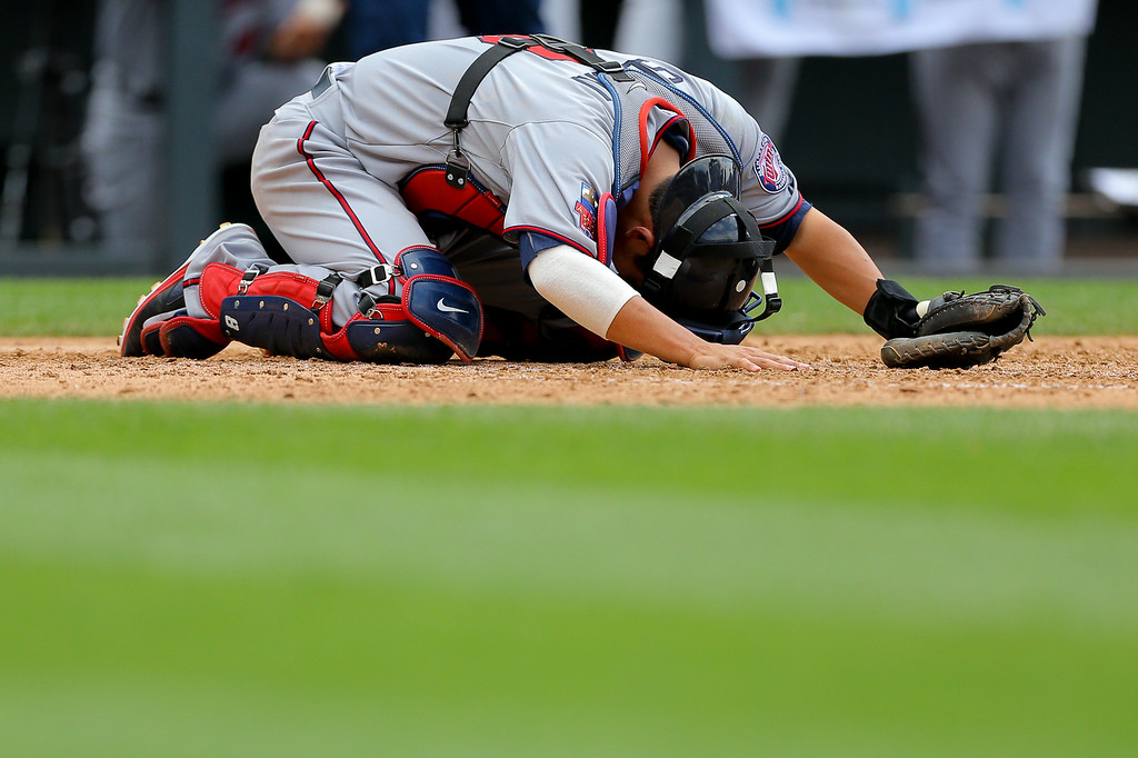 . Catcher Kurt Suzuki #8 of the Minnesota Twins lies on the ground in pain after a foul ball hit him during the fifth inning. (Photo by Justin Edmonds/Getty Images)