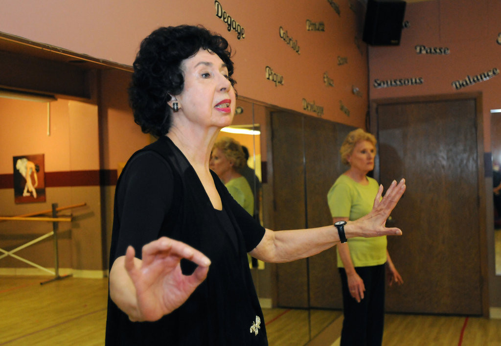 . Nancy Raddatz, instructs her class as they finish the  modern lyrical portion of their Wednesday night class. At right is student Louise Lentz, who has been dancing with Raddatz since 2008. (Pioneer Press: Ginger Pinson)