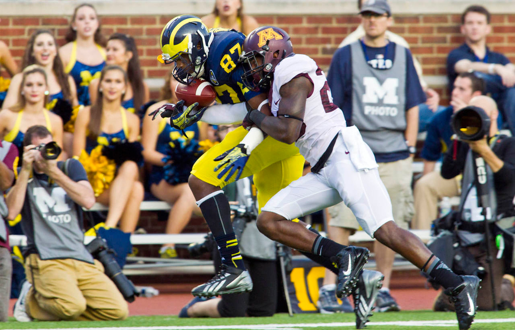 . Michigan tight end Devin Funchess catches a 47-yard pass as Minnesota defensive back Jeremy Baltazar defends in the fourth quarter. (AP Photo/Tony Ding)