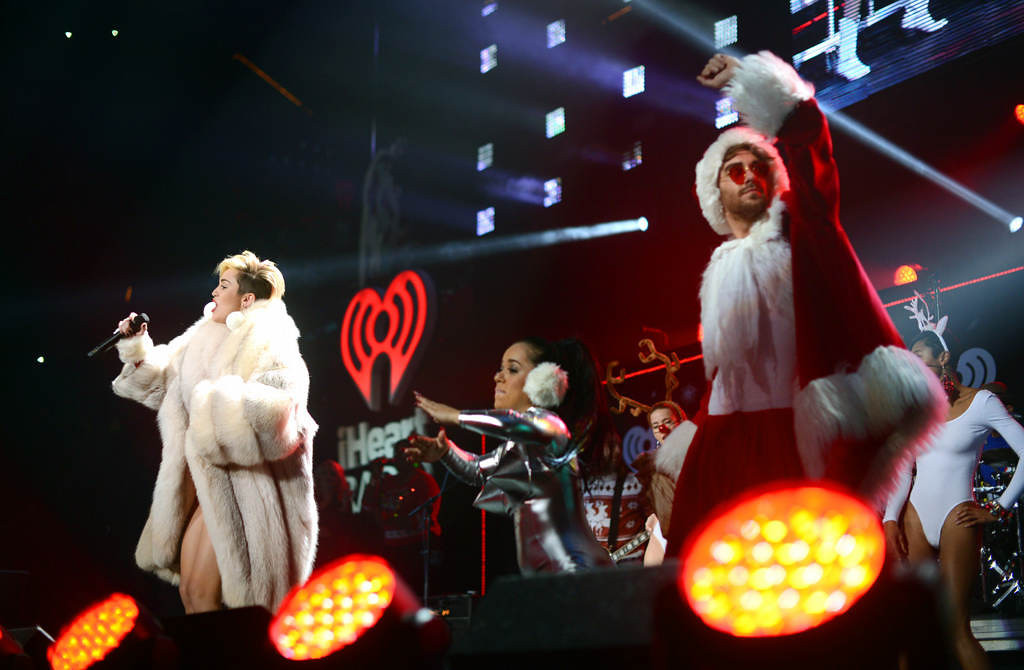 """. Miley Cyrus sings \""""Party in the USA\"""" with her group at Xcel Energy Center in St. Paul, Tuesday, December 10, 2013. (Pioneer Press: Chris Polydoroff)"""