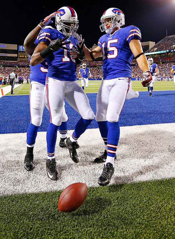 . Buffalo Bills\' Brad Smith (16) celebrates with teammates Chris Hogan (15) and Zach Brown, left rear, after scoring a touchdown during the second half of an NFL preseason football game against the Minnesota Vikings on Friday, Aug. 16, 2013, in Orchard Park, N.Y.  (AP Photo/Bill Wippert)