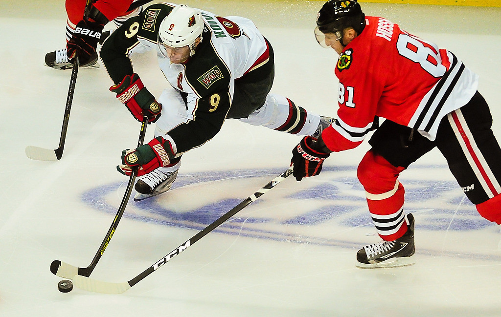 . Minnesota Wild center Mikko Koivu skates past Chicago Blackhawks right wing Marian Hossa during the first period. (Pioneer Press: Ben Garvin)