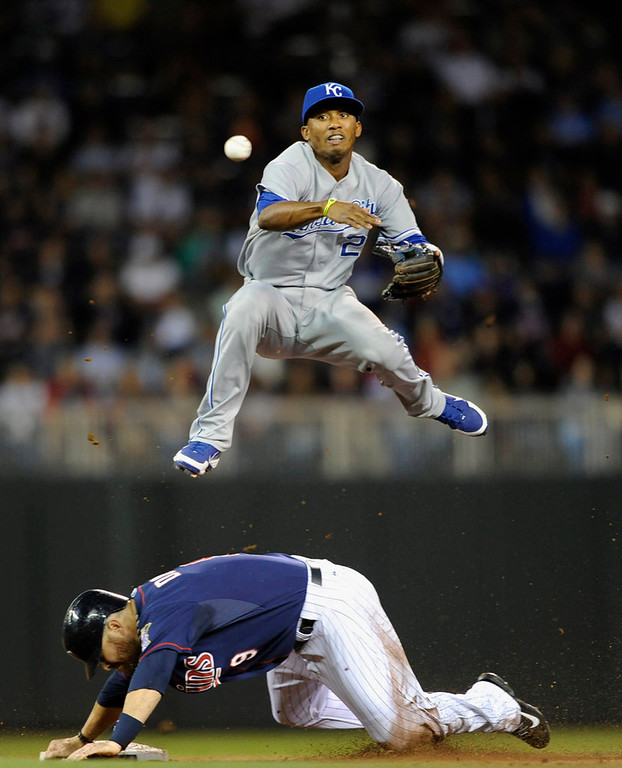 . Ryan Doumit #9 of the Minnesota Twins is out at second base as Alcides Escobar #2 of the Kansas City Royals attempts to complete a double play during the fourth inning. (Photo by Hannah Foslien/Getty Images)
