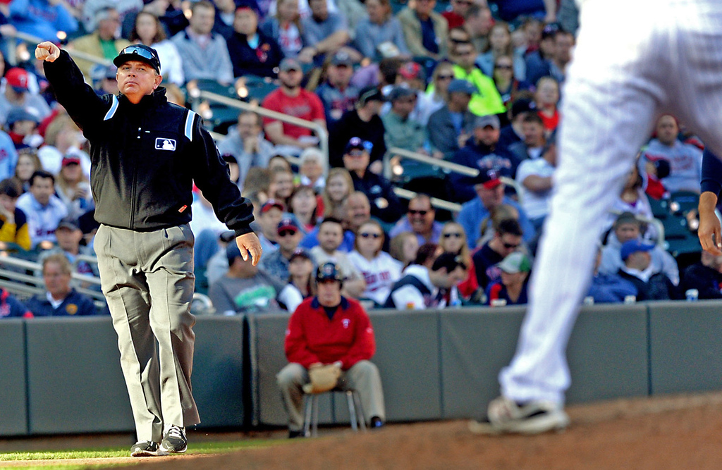 . Umpire Adam Hamari signals the Oakland base runners to advance after Twins reliever Samuel Deduno was called for a balk against the A\'s in the seventh inning. (Pioneer Press: John Autey)