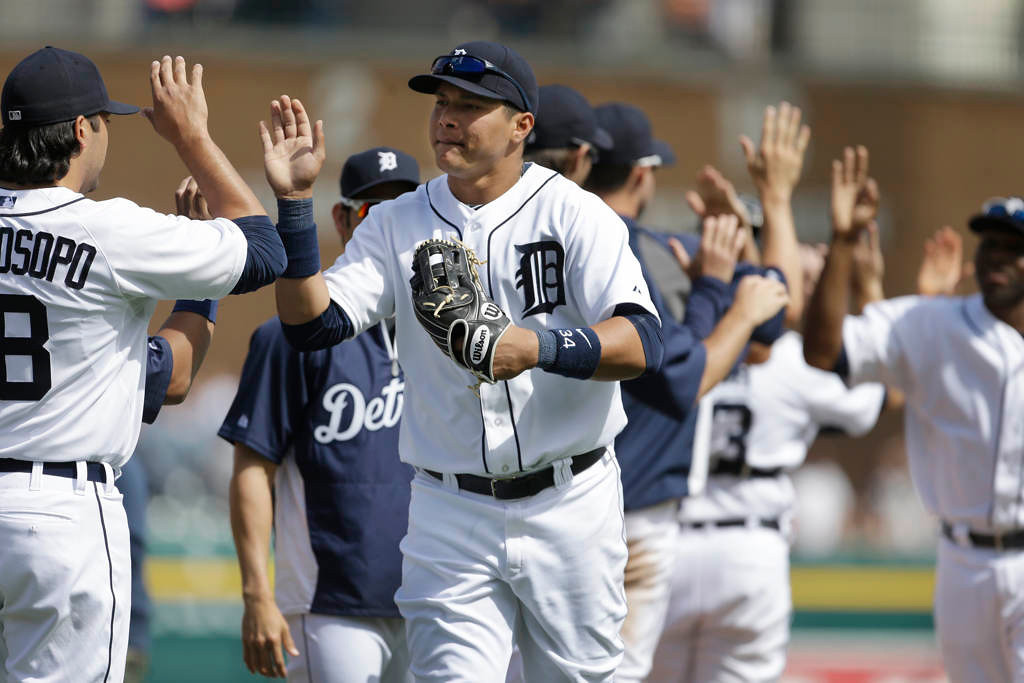 . Detroit Tigers right fielder Avisail Garcia, center, high-fives teammate Matt Tuiasosopo after their baseball game against the Minnesota Twins in Detroit, Sunday, May 26, 2013. Garcia hit a three-run triple in the sixth inning to help the Tigers defeat the Twins 6-1. (AP Photo/Carlos Osorio)