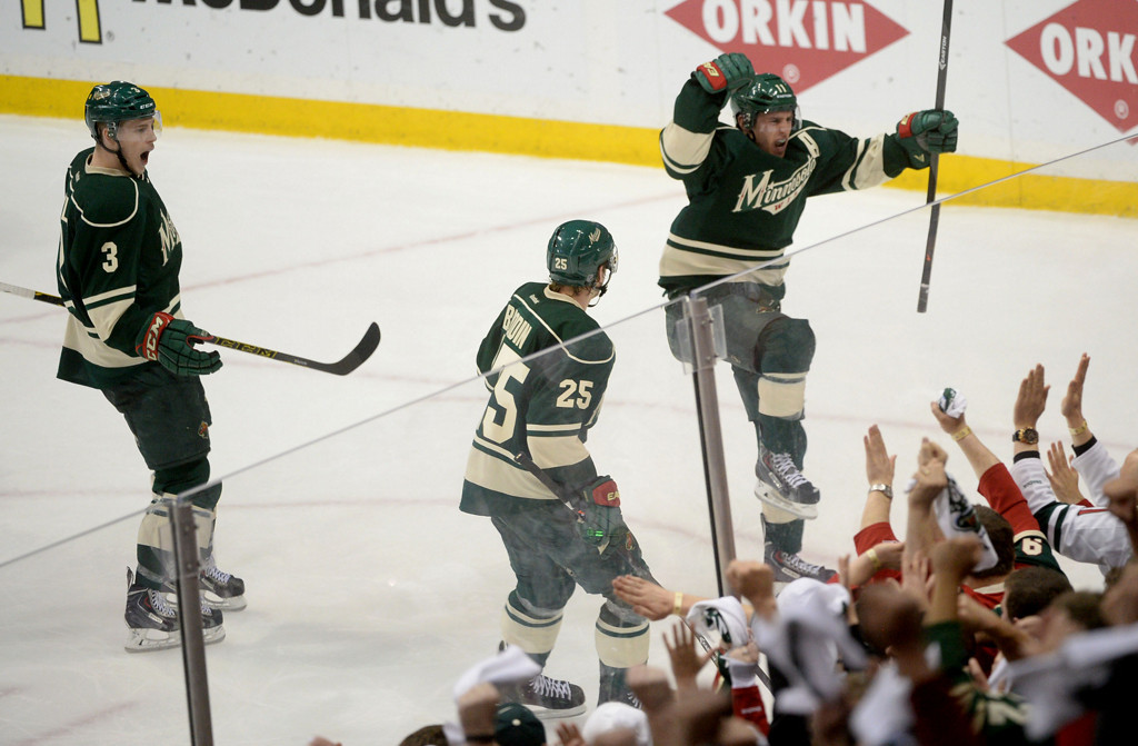 . The Minnesota Wild\'s Zach Parise, right, celebrates his goal during the third period with teammates Jonas Brodin, center, and Charlie Coyle.  (Pioneer Press: Sherri LaRose-Chiglo)