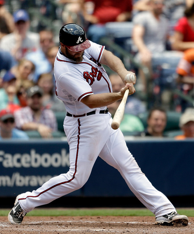 . Atlanta\'s Evan Gattis hits a grand slam over the right-field fence in the fourth inning against the Twins. (AP Photo/David Goldman)