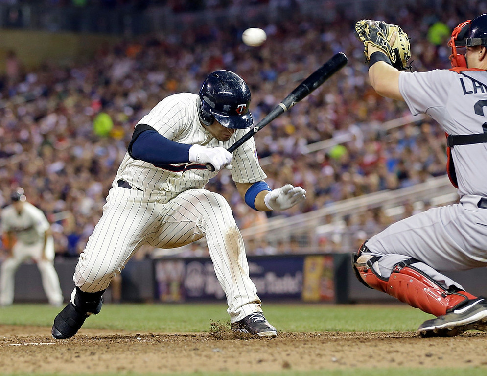 . Minnesota Twins\' Oswaldo Arcia ducks away from a close pitch from Boston\'s Clayton Mortensen in the sixth inning. (AP Photo/Jim Mone)