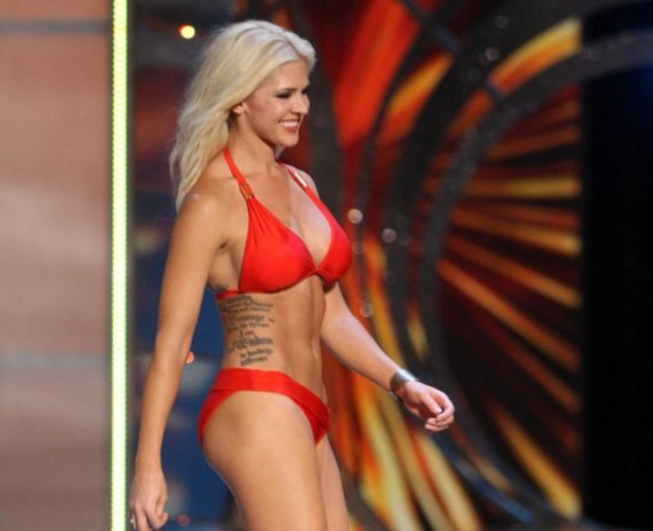 """. <p><b> Miss Kansas, Theresa Vail, caused a stir at the Miss America pageant by openly displaying this during the swimsuit competition � </b> <p> A. Her �Serenity Prayer� tattoo  <p> B. Her surgical scar  <p> C. Her Adam�s apple <p><b><a href=\'http://www.usatoday.com/story/life/people/2013/09/13/miss-america-contestant-shows-her-tattoos/2808757/\' target=\""""_blank\"""">HUH?</a></b> <p>    (AP Photo/The Press of Atlantic City, Edward Lea)"""