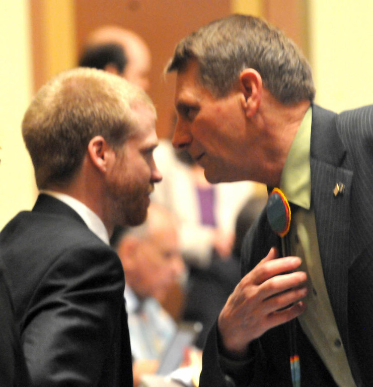 . Majority whip John Persell, DFL-Bemidji, right, buttonholes Rep. Ben Lien, DFL-Moorhead, before a vote on the child care unionization bill Monday afternoon. (Pioneer Press: John Doman)