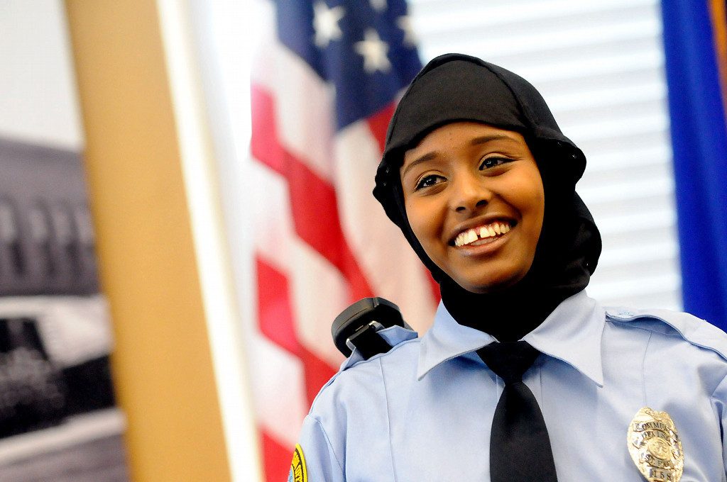 . St. Paul Community Officer Kadra Mohamed smiles after receiving her badge from St. Paul Police Chief Tom Smith on Saturday. The police department introduced the hijab headscarf during the ceremony and Mohamed is the first officer in Minnesota to wear one. (Pioneer Press: Sherri LaRose-Chiglo)