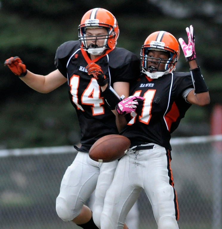 . Humboldt\'s James Jackson, right, and Billy Robles celebrate Jackson\'s touchdown against Minneapolis Edison in the second half. (Special to the Pioneer Press: A.J. Olmscheid)