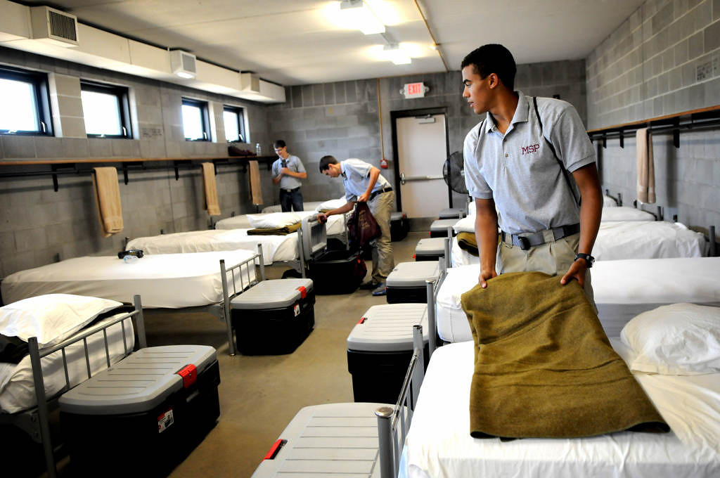 """. Tyler Hemp, 17, of Bemidji, folds the blanket on his bed during a Minnesota State Patrol High School Summer Camp at Camp Ripley, near Little Falls. \""""I\'m here \'cause I feel that this is what I want to do with my future,\"""" said Hemp.  (Pioneer Press: Jean Pieri)"""