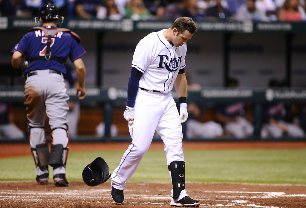 . Tampa Bay Rays\' Evan Longoria tosses down his helmet as he reacts after striking out swinging to Minnesota Twins starting pitcher Samuel Deduno to end the third inning.(AP Photo/Brian Blanco)