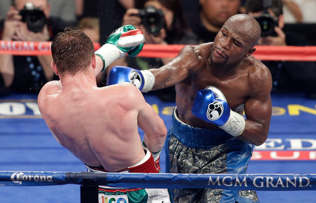 ". <p><b> Boxing champ Floyd Mayweather Jr., with much fanfare, announced his May 3 multimillion-dollar fight against � </b> <p> A. Marcos Maidana <p> B. Robert Guerrero <p> C. His girlfriend <p><b><a href=\'http://www.usatoday.com/story/sports/boxing/2014/02/24/boxing-mayweather-to-fight-maidana-in-may-3rd-unification-bout/5797283/\' target=""_blank\"">HUH?</a></b> <p>    (AP Photo/Isaac Brekken)"