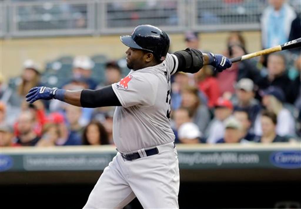. Boston\'s David Ortiz hits an RBI single off Minnesota Twins pitcher Vance Worley in the first inning.  (AP Photo/Jim Mone)