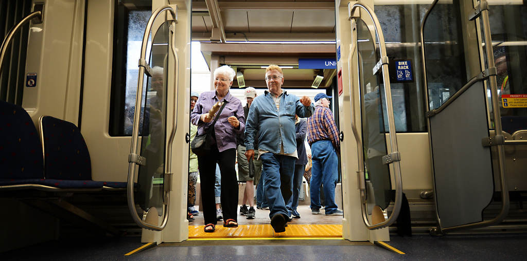 . A couple board the train Saturday, June 14, 2014, during the Metro Transit Green Line Grand Opening in St. Paul. (Pioneer Press: John Autey)